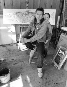 Rick Bartow and son in art studio