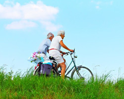 Two older people on bikes