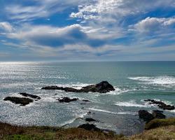 The ocean, rocks, waves, sky, clouds
